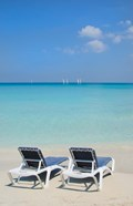 Sand and beach chairs await tourists, Varadero, Cuba