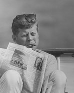 John F Kennedy Smoking a Cigar