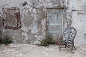 Old Building chair and doorway in town of Oia, Santorini, Greece