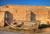 Old fishing boat on dry land, Oia, Santorini, Greece