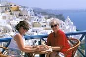 Women Having Coffee on Cafe Terrace, Santorini, Greece