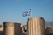 Greece, Athens, Acropolis Column ruins and Greek Flag