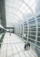 Business Travelers in Modern Airport