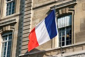 French Flag Facade of Justice Palace Paris, France