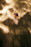 Birds-eye view of kayaker on Androscoggin River, blurred motion, New Hampshire