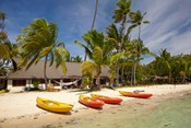 Kayak on the beach, and waterfront bure, Plantation Island Resort, Malolo Lailai Island, Mamanuca Islands, Fiji