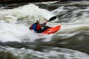 Kayaker plays in a hole in Tariffville Gorge, Farmington River in Tariffville, Connecticut