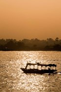 Egypt, Luxor Water taxi at sunset Nile River