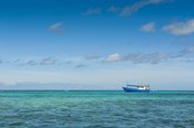Fishing boat in the turquoise waters of the blue lagoon, Yasawa, Fiji, South Pacific