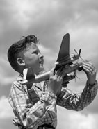 1930s 1940s 1950s  Freckle-Faced Boy Holding Airplane