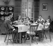 1930s Family Of 6 Sitting At The Table