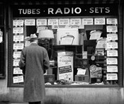 1940s Man Looking At Window Display Of Radios