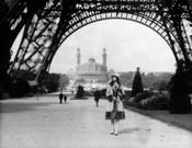 1920s Woman Walking Under The Eiffel Tower