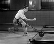 1950s Side View Of Man Bowling