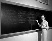 1950s Teacher In Front Of Classroom