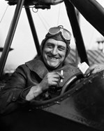 1920s Smiling Man Pilot In Cockpit Of Airplane