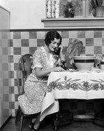 1920s Woman Sitting At Kitchen Table