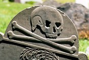 Skull And Crossbones Carved On Tombstone