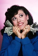Excited Brunette Woman Holding Several Dollar Bills
