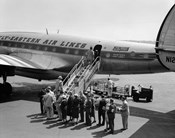 1950s Group Of Passengers Boarding Airplane