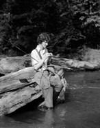 1920s 1930s Woman Sitting On Rock