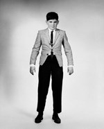 1950s 1960s Overgrown Boy Looking At Camera