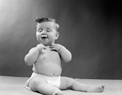 1950s Baby Seated With Eyes Closed
