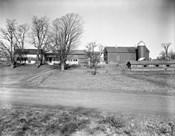 1920s Rural Farmhouse Farm Barn And Barnyard
