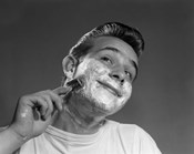 1950s Young Man Shaving With Safety Razor