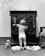 1940s Toddler Baby Pulling Clothes Out Of Bureau