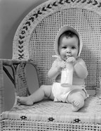1940s Baby Sitting In Wicker Chair
