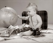 1960s Baby Seated Looking At Globe