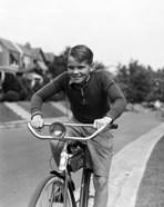 1930s Smiling Boy Riding Bicycle