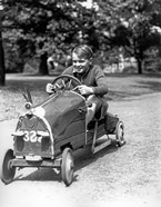 1930s Boy Driving Home In Race Car