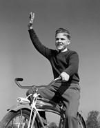 1940s 1950s Smiling Boy Riding Bike Waving