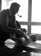 1950s Silhouetted By Window Light  Father Pipe In Mouth