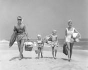 1950s Family Of Four Walking Towards Camera