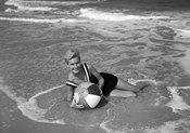 1960s Woman In Bathing Suit Lying In The Surf