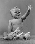 1950s Laughing Baby Surrounded By Little Baby Chicks