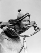 1930s Smiling Eager Little Girl In Knit Cap And Sweater Riding Bike