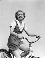 1930s Smiling Blonde Woman Riding Bicycle