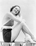 1930s  Smiling Brunette Woman Wearing Striped Halter Top