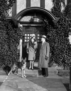 1920s Couple Wearing Coat Hat Gloves With German Shepherd Dog