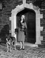 1920s Woman Wearing Fur Coat With German Shepherd Dog