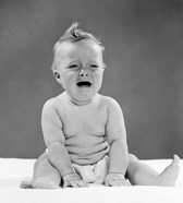 1950s Crying Baby Seated With Distressed Expression?