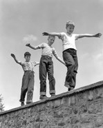 1950s Three Laughing Boys Walking On Top Of Stone Wall