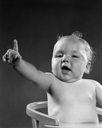 1940s 1950s Baby Sitting In Chair Arm And One Finger Raised