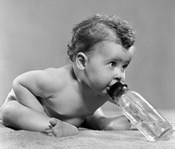 1950s Baby Leaning Forward Drinking From Bottle