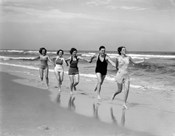 1930s Four Women And One Man Running On Beach