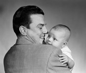 1950s Proud Smiling Father Holding Baby Face To Camera